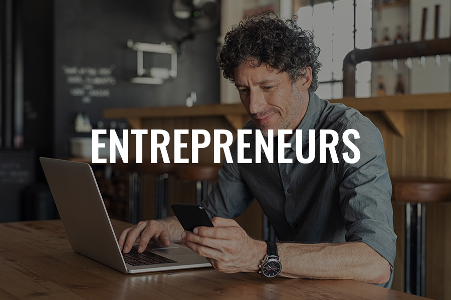 Picture of brewery owner on computer with the words Entrepreneurs